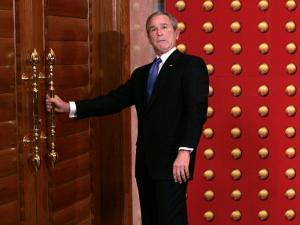 President George W. Bush as He Tries to Open a Locked Door Leaving a Press Conference in Beijing