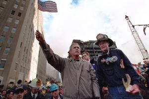 President George W. Bush Waves an American Flag after Addressing Recovery Workers in Nyc