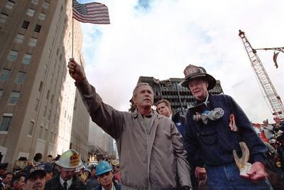 https://imgc.allpostersimages.com/img/posters/president-george-w-bush-waves-an-american-flag-after-addressing-recovery-workers-in-nyc_u-L-Q10WSIA0.jpg?p=0