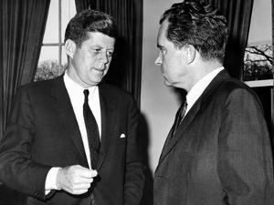 President John Kennedy Confers with Former Vice President Richard Nixon