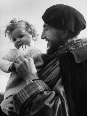 Priest Abbe Pierre Groues, Holding a Small Child