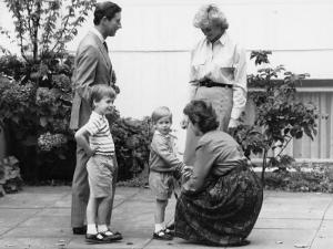 Prince Charles and Princess Diana with Prince William and Prince Harry, meet the headmistress as Ha