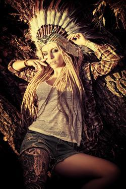 Attractive Modern Girl in Style of the American Indians. Western Style. Jeans Fashion. Tattoo. by prometeus