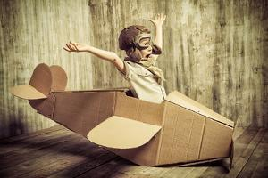Cute Dreamer Boy Playing with a Cardboard Airplane. Childhood. Fantasy, Imagination. Retro Style. by prometeus
