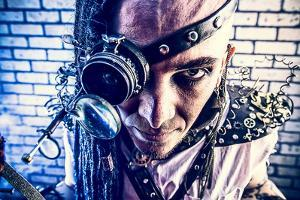 Portrait Of A Steampunk Man With A Mechanical Devices Over Brick Wall by prometeus