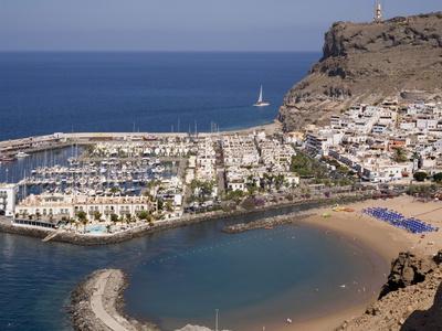 https://imgc.allpostersimages.com/img/posters/puerto-and-playa-mogan-grand-canary-canary-islands-spain-atlantic-europe_u-L-PFNNVS0.jpg?p=0
