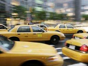 Moving New York Taxis, Manhattan, New York, United States of America, North America by Purcell-Holmes