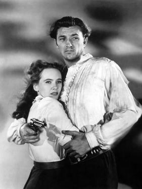 PURSUED, 1947 directed by RAOUL WALSH Teresa Wright and Robert Mitchum (b/w photo)