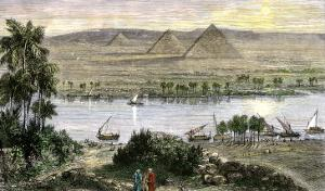 Pyramids at Gizeh, with Dhows on the Nile River in Egypt