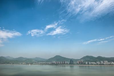 https://imgc.allpostersimages.com/img/posters/qiantang-river-hills-and-high-rises-of-hangzhou-zhejiang-china_u-L-PWFEC70.jpg?p=0