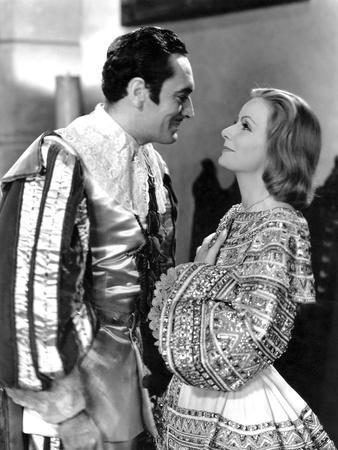 https://imgc.allpostersimages.com/img/posters/queen-christina-1933-directed-by-rouben-mamoulian-john-gilbert-greta-garbo-b-w-photo_u-L-Q1C1I9Y0.jpg?artPerspective=n