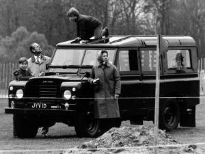 Queen Elizabeth II Looks on as Prince Edward Plays on the Roof of Their Land Rover