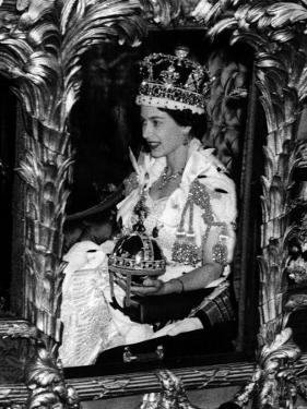 Queen Elizabeth II Riding Along in the Coronation Coach Wearing Crown and Carrying Orb