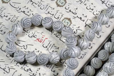 https://imgc.allpostersimages.com/img/posters/quran-and-tasbih-prayer-beads-with-allah-monogram-in-red-france_u-L-Q1GYKA40.jpg?artPerspective=n