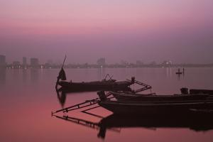 Boats at Sunset at West Lake, Hanoi, Vietnam by Quynh Anh Nguyen