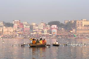 Hindu Pilgrims on Boat in the Ganges River, Varanasi, India by R M Nunes