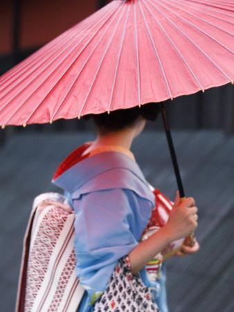 Geisha with Umbrella in Gion District by Rachel Lewis