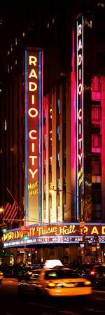 https://imgc.allpostersimages.com/img/posters/radio-city-music-hall-and-yellow-cab-by-night-manhattan-times-square-new-york-city_u-L-PZ22NF0.jpg?p=0