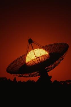 Radio Telescope Silhouetted by Setting Sun