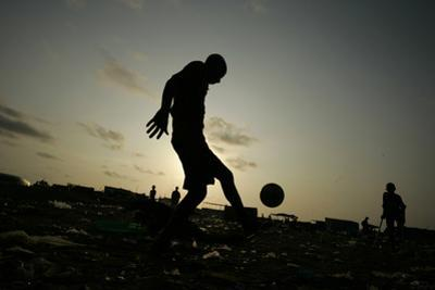 Angolan Youths Play Soccer in the Streets of the Capital Luanda