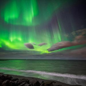 Northern Lights over the Waves Breakiing on the Beach in Seltjarnarnes, Reykjavik, Iceland by Ragnar Th Sigurdsson