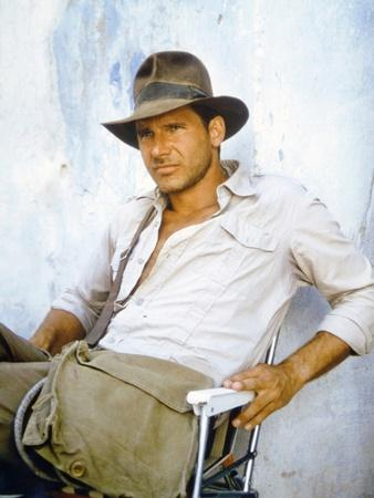 https://imgc.allpostersimages.com/img/posters/raiders-of-the-lost-ark-1981-on-the-set-harrison-ford-photo_u-L-Q1C1GRJ0.jpg?artPerspective=n
