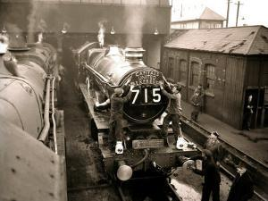 """Railway Workers Cleaning the Cardiff Rail Name Plate """"Capitals United Express"""", Wales 1950s"""