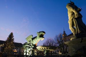 Austria, Carinthia, Klagenfurt, Lindwurm-Fountain, Twilight by Rainer Mirau