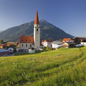 Austria, Tyrol, Ort Wald, Tschirgant, Church, Meadow by Rainer Mirau