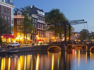 Houses in the Kloveniersburgwal, Lights, Reflexion, in the Evening, Amsterdam, the Netherlands by Rainer Mirau