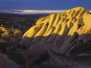 Illuminateded Tuff Stone Erosion with Uchisar, Cappadocia, Anatolia, Turkey by Rainer Mirau
