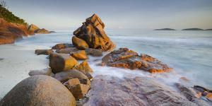 Red Granite at Anse Gaulettes, La Digue Island, the Seychelles by Rainer Mirau