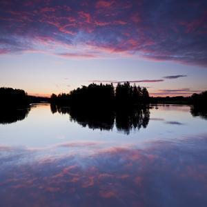 Sweden, Batfors Nature Reserve, River, Islands, Clouds by Rainer Mirau