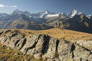 Two Hikers, Ober Gabelhorn, Zinalrothorn, Weisshorn, Zermatt, Valais, Switzerland by Rainer Mirau