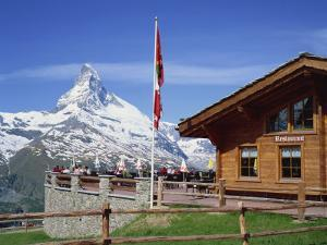 Tourists on the Balcony of the Restaurant at Sunnegga Looking at the Matterhorn in Switzerland by Rainford Roy