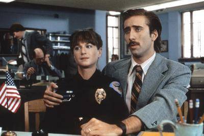 https://imgc.allpostersimages.com/img/posters/raisin-arizona-1987-directed-by-joel-and-ethan-coen-holly-hunter-and-nicolas-cage-photo_u-L-Q1C11420.jpg?artPerspective=n