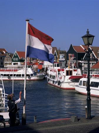 Raising the Dutch Flag by the Harbour, Volendam, Ijsselmeer, Holland by I Vanderharst