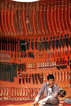 https://imgc.allpostersimages.com/img/posters/rajasthani-traditional-knife-seller-pushkar-rajasthan-india_u-L-Q1GYKXR0.jpg?artPerspective=n