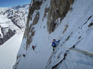 Expedition Members Traverse the Edge of K2's North Ridge by Ralf Dujmovits