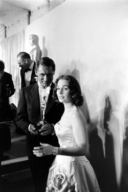 Actress Gene Simmons and Cary Grant Backstage at the 30th Academy Awards, 1958 by Ralph Crane