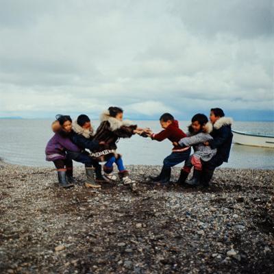 Alaska: Native Alaskan Children Playing a Game of Tug-Of-War by Ralph Crane