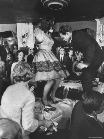 American Couples Dancing in Hollywood Nightclub by Ralph Crane