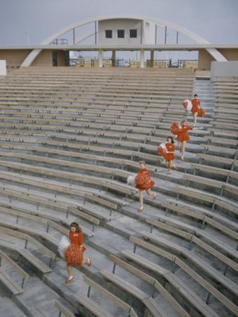Bakersfield Junior College: Cheerleaders Practicing for Football Rally by Ralph Crane