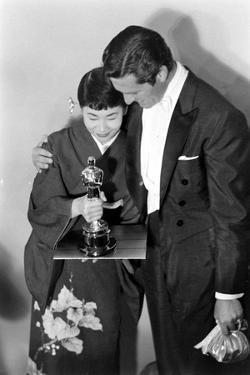 Best Supporting Actress Miyoshi Umeki with Actor John Wayne at the 30th Academy Awards, 1958 by Ralph Crane