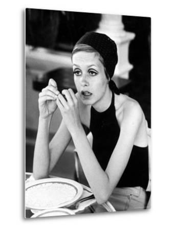 British Fashion Model Twiggy with Slumpy Posture, at Table in Restaurant at Disneyland by Ralph Crane