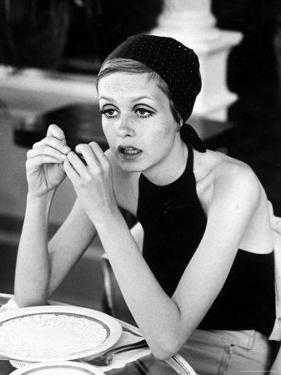 British Fashion Model Twiggy with Slumpy Posture, at Table in Restaurant at Disneyland by Ralph Crane