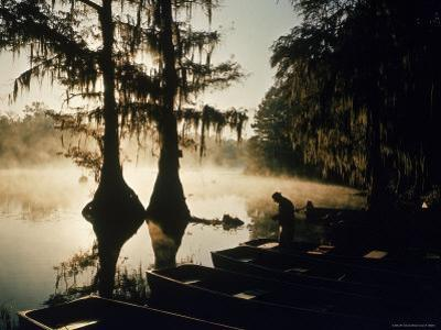 Classic Southern Scene of Fisherman Readying Equipment by the Texas/Louisiana Border by Ralph Crane