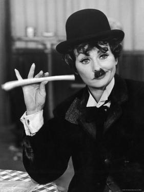 Comedien/Actress Lucille Ball imitating Charlie Chaplin on her New Year's TV show by Ralph Crane
