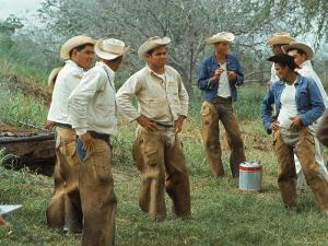 Cowboys on the King Ranch Stand Around During a Break from Rounding Up Cattle by Ralph Crane