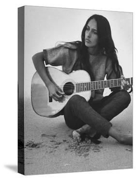 Folk Singer Joan Baez Strumming Her Guitar on the Beach Near Her Home by Ralph Crane